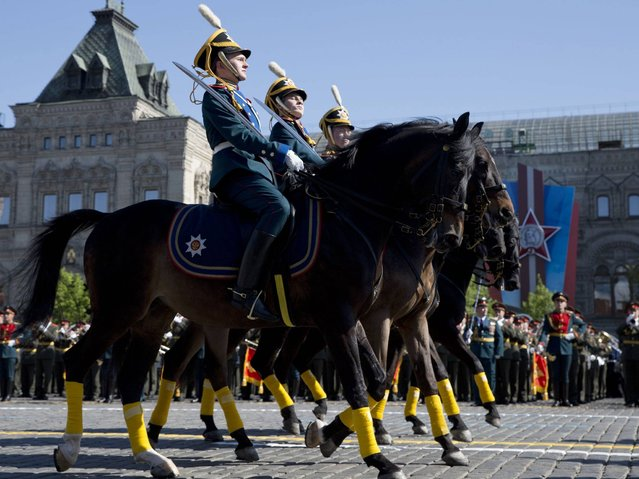 Russian soldiers ride horses during the Victory Day Parade in Moscow. (Photo by Pavel Golovkin/AP Photo)