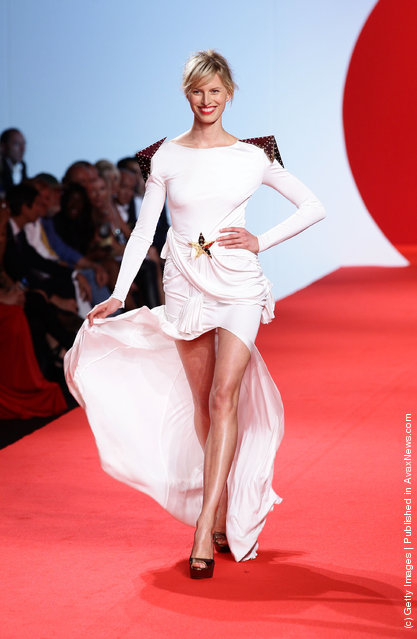 Model Karolina Kurkova walks the runway at the Fashion For Relief at Forville market during the 64th Annual Cannes Film Festival
