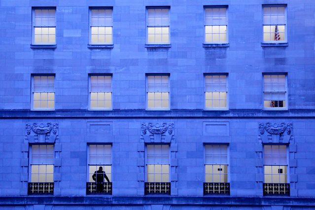 A man looks out a window in a seemingly empty Longworth House Office Building ahead of testimony by U.S. Army Lt. Col. Alexander Vindman, director for European Affairs at the National Security Council, and Jennifer Williams, a special adviser to Vice President Mike Pence for European and Russian affairs, before a House Intelligence Committee hearing as part of the impeachment inquiry into U.S. President Trump on Capitol Hill in Washington, U.S. November 19, 2019. (Photo by Jonathan Ernst/Reuters)