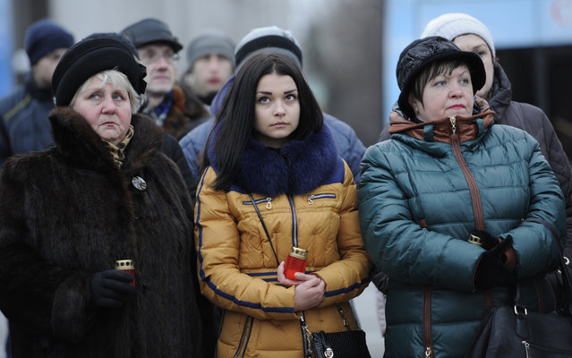 Residents of the self-proclaimd Donetsk People's Republic take part in a vigil for children killed in the conflict opposing seperatist rebels to Ukrainian troops, in Donetsk on March 17, 2015. The vigil takes place after a young girl was accidentally killed by a Ukrainian armoured vehicle in the Ukrainian-held town of Konstantinovka March 16, 2015, sparking riots there. (Photo by Alexander Gayuk/AFP Photo)