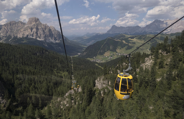 The Boe cable car in the Dolomite Mountains is seen near the town of Corvara in northern Italy July 19, 2015. (Photo by Bob Strong/Reuters)