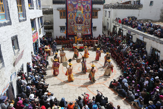 Elaborately dressed monks perform ceremonial dances during the Tenchi Festival on May 26, 2014 in Lo Manthang, Nepal. The Tenchi Festival takes place annually in Lo Manthang, the capital of Upper Mustang and the former Tibetan Kingdom of Lo. Each spring, monks perform ceremonies, rites, and dances during the Tenchi Festival to dispel evils and demons from the former kingdom. (Photo by Taylor Weidman/Getty Images)