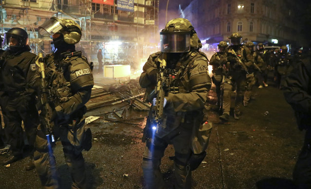German special police forces walk through the Schanze district following clashes with anti G20-protesters in Hamburg, Germany, July 7, 2017. (Photo by Kai Pfaffenbach/Reuters)