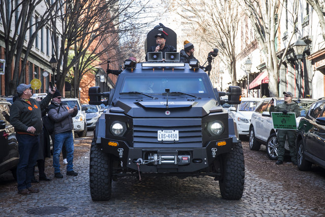 InfoWars host Alex Jones rides in an armored vehicle during a rally organized by The Virginia Citizens Defense League on Capitol Square near the state capitol building on January 20, 2020 in Richmond, Virginia. During elections last year, Virginia Governor Ralph Northam promised to enact sweeping gun control laws in 2020, including limiting handgun purchase to one per month, banning military-style weapons and silencers, allowing localities to ban guns in public spaces and enacting a 'red flag' law so authorities can temporarily seize weapons from someone deemed a threat. While event organizers have asked supporters to show up un-armed, militias and other far-right groups from across the country plan to attend the rally and show their support for gun rights. (Photo by Zach Gibson/Getty Images)