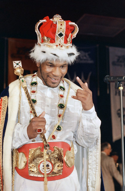 Mike Tyson celebrates his victory over Tony Tucker at the coronation gala following his world boxing heavyweight championship fight in Las Vegas, Saturday, August 2, 1987. Tyson became the first undisputed heavyweight champion since 1978. The gala was sponsored by promoter Dong King to culminate a 18-month-long tournament to unify the heavyweight division. (Photo by Jeff Widener/AP Photo)