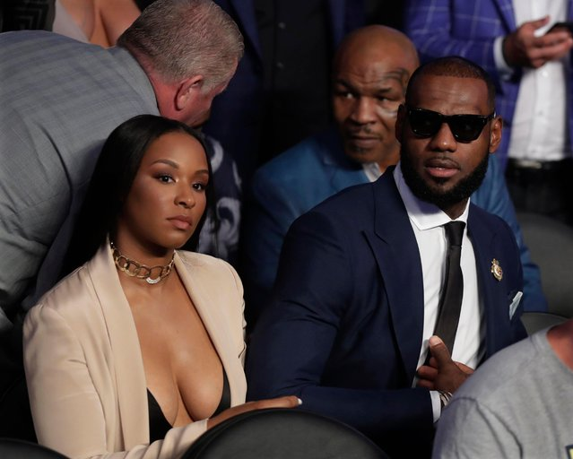 NBA legend LeBron James waits for a super welterweight boxing match between Floyd Mayweather Jr. and Conor McGregor on Saturday, August 26, 2017, in Las Vegas. Former boxer Mike Tyson sits behind James. (Photo by Isaac Brekken/AP Photo)