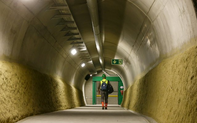 A journalist walks through an an emergency tunnel at a multifunction and emergency stop station of the NEAT Gotthard Base Tunnel during a media visit near the town of Sedrun August 24, 2015. (Photo by Arnd Wiegmann/Reuters)