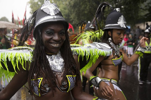 Performers take part in the Notting Hill Carnival in west London August 25, 2014. (Photo by Neil Hall/Reuters)