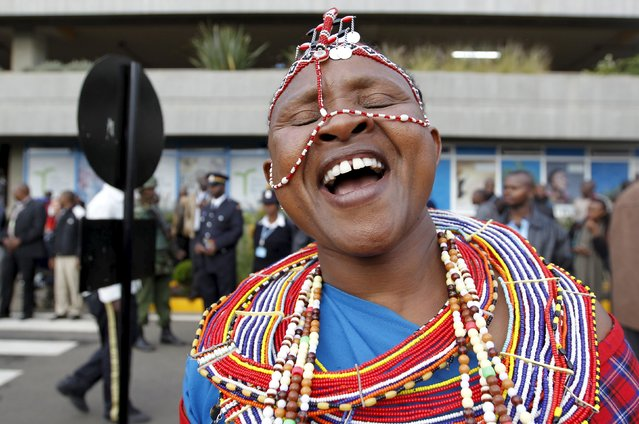 A Maasai woman in traditional clothing celebrates as she welcomes the national athletics team at the Jomo Kenyatta airport in Nairobi, September 1, 2015, after they topped the medals table at the recently concluded 15th International Association of Athletics Federations (IAAF) World Championships at the National Stadium in Beijing, China. (Photo by Thomas Mukoya/Reuters)