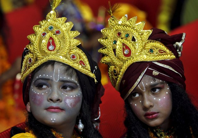 Children dressed as Hindu Lord Krishna wait to participate in a fancy dress competition at a temple before the Janmashtami festival in Chandigarh, India, September 3, 2015. The festival, which marks the birth anniversary of Lord Krishna, will be celebrated across India on Saturday. (Photo by Ajay Verma/Reuters)