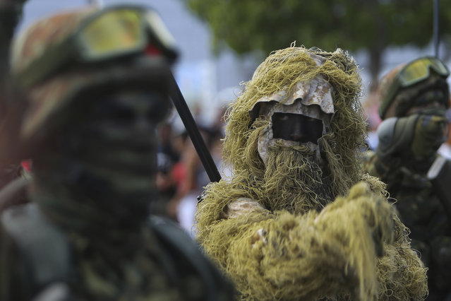 Greece soldiers in camouflage attire take part in a military parade marking the 57 years celebrations of independence in Nicosia in the divided island of Cyprus, Sunday, October 1, 2017. The island of Cyprus has been divided since 1974, when Turkey invaded in response to a coup aimed at uniting the island with Greece. Cyprus gained independence from Britain in 1960. (Photo by Petros Karadjias/AP Photo)