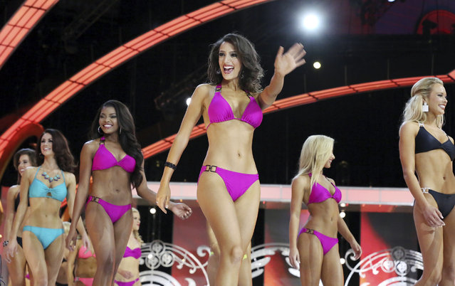 Miss America contestants compete in the swimsuit preliminary of the Miss America pageant at Boardwalk Hall in Atlantic City, N.J., Tuesday, September 9, 2014. (Photo by Edward Lea/AP Photo/The Press of Atlantic City)