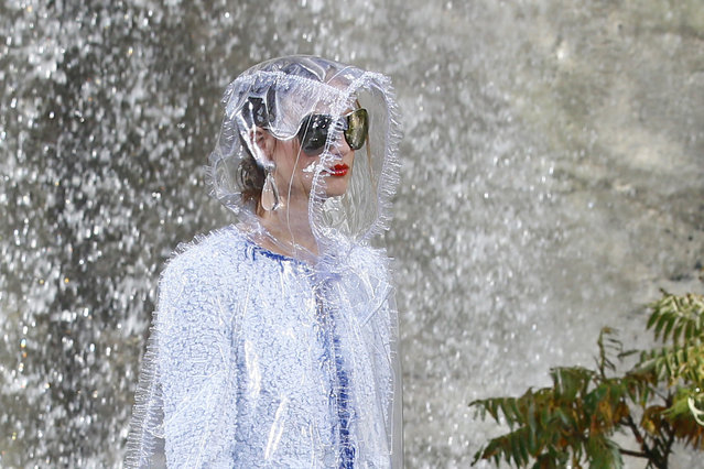 A model wears a creation for the Chanel Spring/Summer 2018 ready-to-wear fashion collection presented in Paris, Tuesday, October 3, 2017. (Photo by Francois Mori/AP Photo)