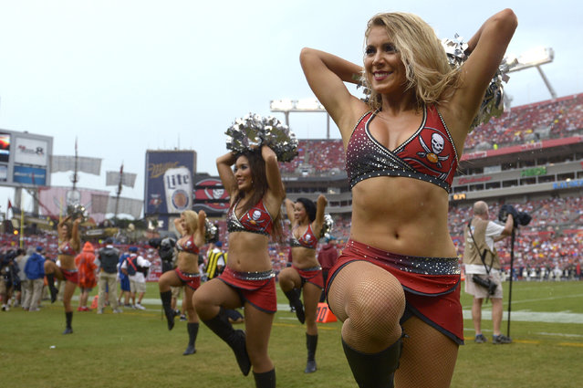 The Tampa Bay Buccaneers cheerleaders perform during the second half of an NFL football game against the St. Louis Rams in Tampa, Fla., Sunday, September 14, 2014. (Photo by Phelan M. Ebenhack/AP Photo)