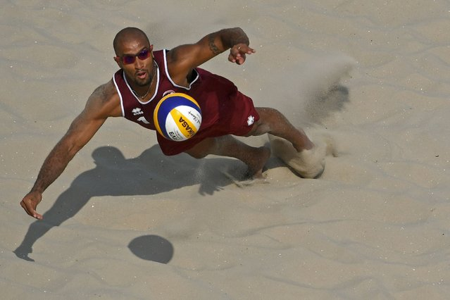 Qatar's Jefferson Santos Pereira plays a shot during the men's beach volleyball qualifying match between Spain and Qatar at the Beach Volley Arena in Rio de Janeiro on August 8, 2016, for the Rio 2016 Olympic Games. (Photo by Yasuyoshi Chiba/AFP Photo)