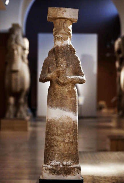 This Monday, September 15, 2014 photo shows, a calcareous stone statue displayed at the Iraqi National Museum in Baghdad. When Islamic State militants overran the northern city of Mosul and surrounding Ninevah province in June, they captured a region were nearly 1,800 of Iraq's 12,000 registered archaeological sites are located. They snapped up even more as they pushed south toward Baghdad. (Photo by Hadi Mizban/AP Photo)