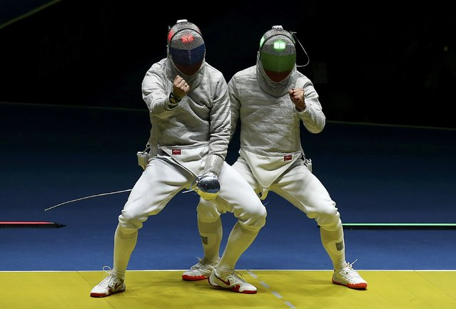 2016 Rio Olympics, Fencing, Preliminary, Men's Sabre Individual Table of 32, Carioca Arena 3, Rio de Janeiro, Brazil  on August 10, 2016. Alexey Yakimenko (RUS) of Russia and Pancho Paskov (BUL) of Bulgaria react. (Photo by Peter Cziborra/Reuters)
