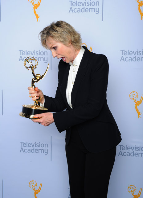 "Jane Lynch, winner of the award for outstanding host for a reality or reality competition program for ""Hollywood Game Night"", poses for a portrait at the Television Academy's Creative Arts Emmy Awards at Microsoft Theater on Saturday, September 12, 2015, in Los Angeles. (Photo by Vince Bucci/Invision for the Television Academy/AP Images)"