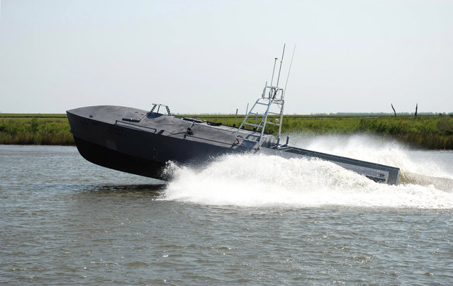 Defense contractor Textron Inc. demonstrates what it calls its Common Unmanned Surface Vessel (CUSV) technology at the company's New Orleans shipyard, on April 12, 2012. Technology that sent unmanned aircraft over warzones in Iraq and Afghanistan soon could be steering unstaffed boats for such dangerous tasks as minesweeping, submarine detection, intelligence gathering and approaching hostile vessels. (Photo by AP Photo/Textron, Inc.)