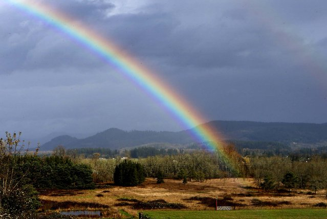 A day after a torrential downpour and wind storm moved through the area, rain clouds part enough for a rainbow to emerge along Highway 58 near Pleasant Hill, Oregon, November 20, 2012. (Photo by Chris Pietsch/The Register-Guard)