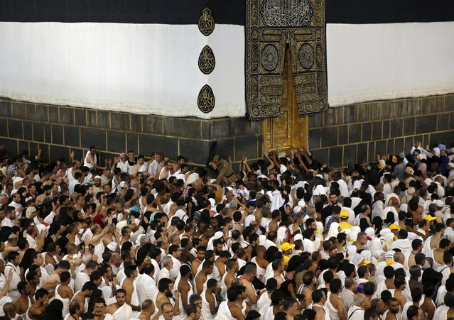 Muslim pilgrims pray around the holy Kaaba at the Grand Mosque ahead of the annual haj pilgrimage in Mecca September 22, 2015. (Photo by Ahmad Masood/Reuters)