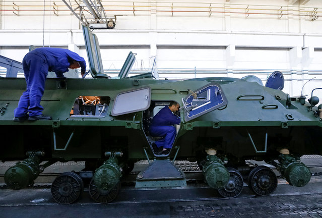 Employees repair an armoured personnel carrier during a media tour at the Kiev armoured plant, Ukraine August 29, 2016. (Photo by Valentyn Ogirenko/Reuters)