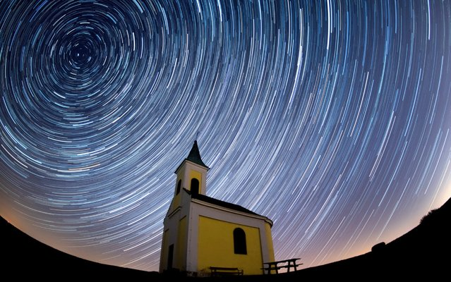 Startrails are seen during the Lyrids meteor shower over Michaelskapelle on April 21, 2020 in Niederhollabrunn, Austria. The clear skies created by the New Moon coincide with the Lyrid meteor shower, an annual display caused by the Earth passing through a cloud of debris from a comet called C/186 Thatcher. (Photo by Thomas Kronsteiner/Getty Images)