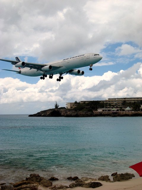"""""""Air Fraance in St. Maarten. The landing pattern at SXM (St. Maarten) takes planes in low over Maho Beach, making shots like these as easy as pointing the camera in the direction of the engine roar"""". (Photo by David Gilford)"""