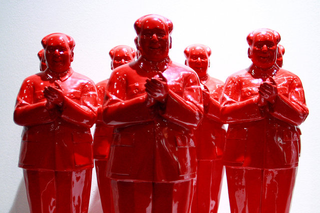 """A sculpture by Huang Gang of China entitled """"Good Good Good"""" is seen at the ARTSingapore art fair at the Suntec Convention Centre in Singapore October 4, 2007. (Photo by Matthew Lee/Reuters)"""