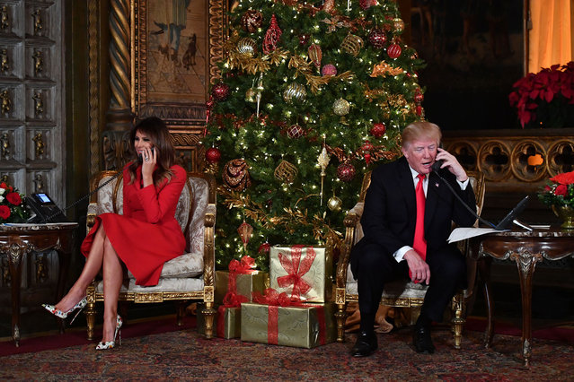 President Donald J. Trump and the First Lady Melania Trump participate in NORAD Santa Tracker phone calls at the Mar-a-Lago resort in Palm Beach, Florida on December 24, 2017. (Photo by Nicholas Kamm/AFP Photo)