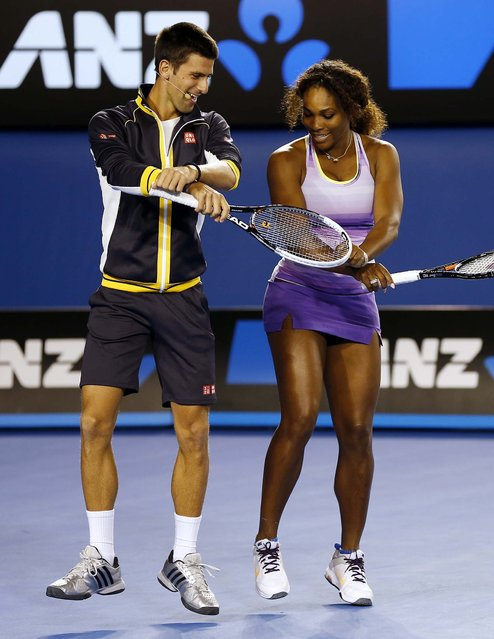 Novak Djokovic and Serena Williams perform the gangnam style dance during the Kids Tennis Day at Melbourne Park, January 11, 2013. (Photo by Andy Wong/Associated Press)