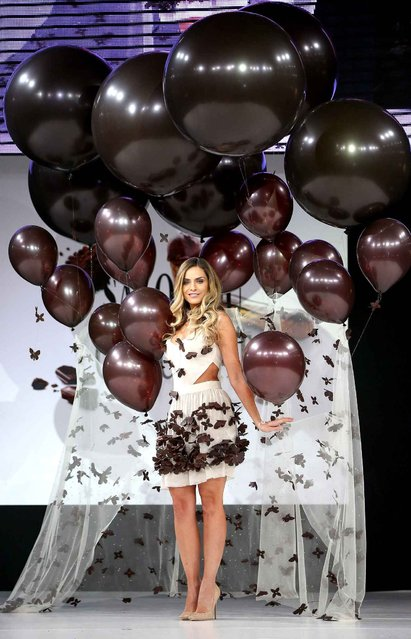 Clara Morgane walks the runway and wears a chocolate costume made by designer and a chocolate maker during the Fashion Chocolate show at Salon du Chocolat at Parc des Expositions Porte de Versailles in Paris, France, October 28, 2014. (Photo by LAURENTVU/SIPA Press)