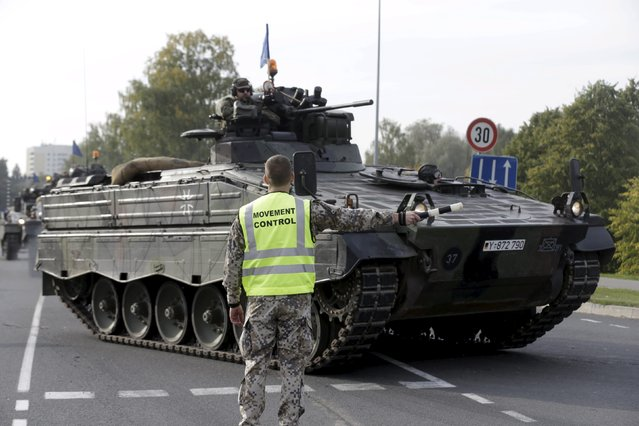 """German army soldiers in their infantry fighting vehicles """"Marder"""" arrive to the NATO military drill in Adazi, Latvia, October 4, 2015. (Photo by Ints Kalnins/Reuters)"""
