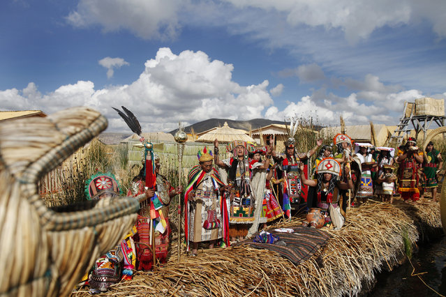Andean actors perform during a re-enactment of the legend of Manco Capac and Mama Ocllo in a Uros island at Lake Titicaca in Puno November 5, 2014. (Photo by Enrique Castro-Mendivil/Reuters)