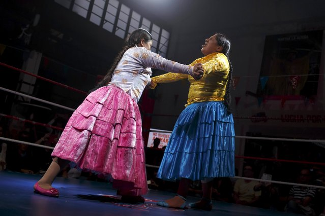 "Bolivian wrestlers Yenny Mamani (R), nicknamed Martha ""La Altena"" and Leonor Cordova, nicknamed Angela ""La Simpatica"", battle during a wrestling bout in Madrid, Spain, October 8, 2015. (Photo by Juan Medina/Reuters)"