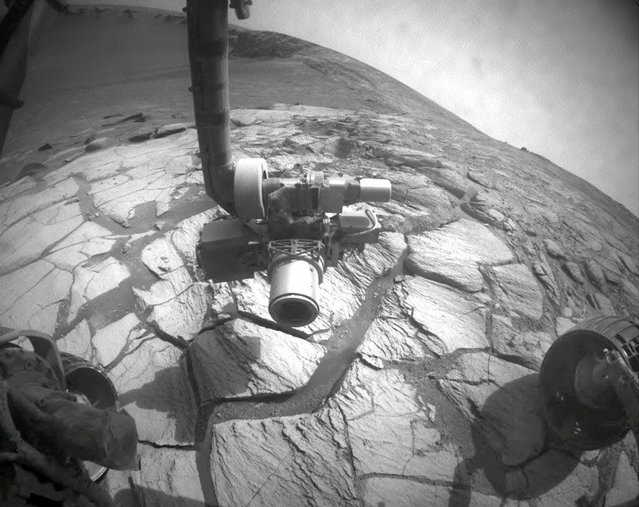 This photo taken by the Mars rover Opportunity's front hazard-identification camera, shows a wide-angle view looking down into and across Victoria Crater. (Photo by AP Photo/NASA, JPL-Caltech/The Atlantic)