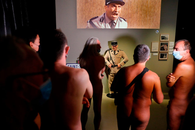 """People take part in a nudist visit of the """"Louis de Funes"""" exhibition at the Cinematheque museum in Paris on September 13, 2020. (Photo by Geoffroy van der Hasselt/AFP Photo)"""