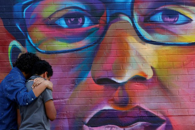 Noah and his older sister visit a mural of Elijah McClain, a 23-year-old Black man who died after an encounter with police officers, ahead of the one-year anniversary of his death in Denver, Colorado, August 8, 2020. (Photo by Kevin Mohatt/Reuters)