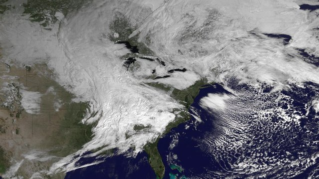 A winter storm system is seen over Canada and the eastern United States in this March 5, 2013 satellite image courtesy of NOAA. The late winter storm dumped heavy snow on the midwestern United States on Tuesday, contributing to numerous highway crashes and flight cancellations as it moved east toward the Ohio Valley and the mid-Atlantic states. (Photo by Reuters/NOAA)