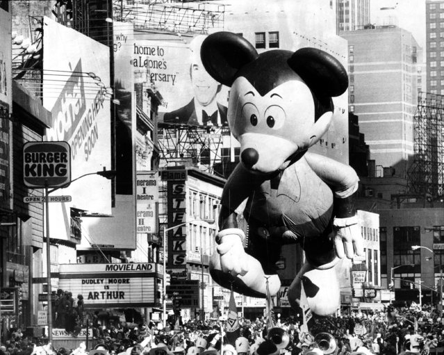 Mickey Mouse takes in Broadway's sights, including a crowd of more than a million, at the 55th annual Macy's Thanksgiving Day Parade, 1981. (Photo by Harry Hamburg/NY Daily News Archive via Getty Images)