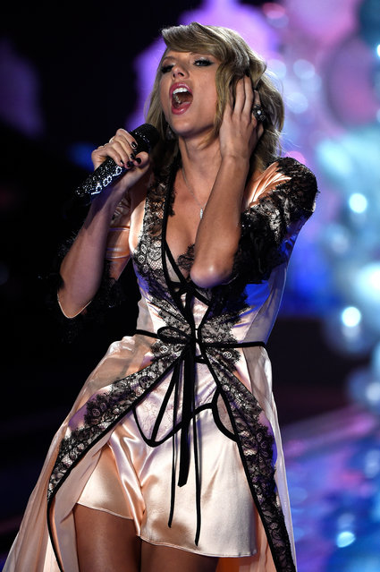 Taylor Swift performs on the runway at the annual Victoria's Secret fashion show at Earls Court on December 2, 2014 in London, England. (Photo by Pascal Le Segretain/Getty Images)