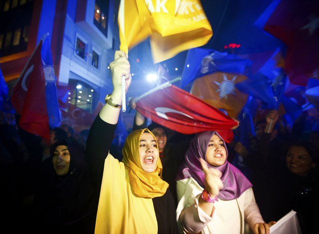 Women wave flags outside the AK Party headquarters in Istanbul, Turkey November 1, 2015. Turks went to the polls in a snap parliamentary election on Sunday under the shadow of mounting internal bloodshed and economic worries, a vote that could determine the trajectory of the polarised country and of President Tayyip Erdogan. (Photo by Osman Orsal/Reuters)