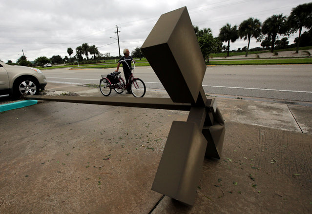 A lamp post is seen on a sidewalk after Hurricane Matthew hits, in Melbourne, Florida, U.S., October 7, 2016. (Photo by Henry Romero/Reuters)