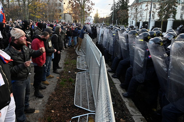 Security forces line up as people take part in a protest against the government's coronavirus disease (COVID-19) restrictions on the country's Day of the Struggle for Freedom and Democracy, in front of the Slovak government building, in Bratislava, Slovakia, November 17, 2020. (Photo by Radovan Stoklasa/Reuters)