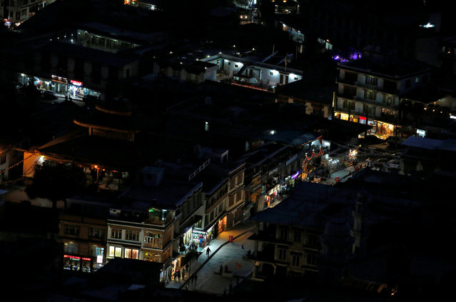 Lights from shops illuminate the city of Leh, the largest town in the region of Ladakh, nestled high in the Indian Himalayas, India September 26, 2016. (Photo by Cathal McNaughton/Reuters)