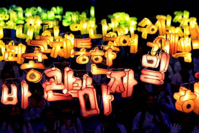 People walk with lanterns as they prepare for the buddha's birthday in Seoul. (Photo by Chung Sung-Jun/Getty Images)