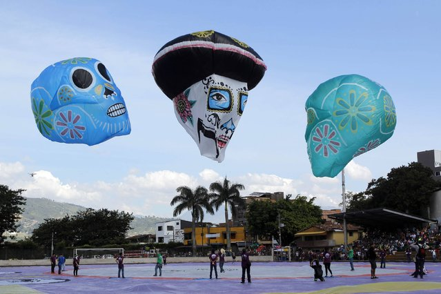 A view of balloons depicting skulls and La Catrina at the 14th Solar Balloon Festival in Envidago December 31, 2014. The festival this year features a theme on Mexican history and culture, according to organizers. (Photo by Fredy Builes/Reuters)