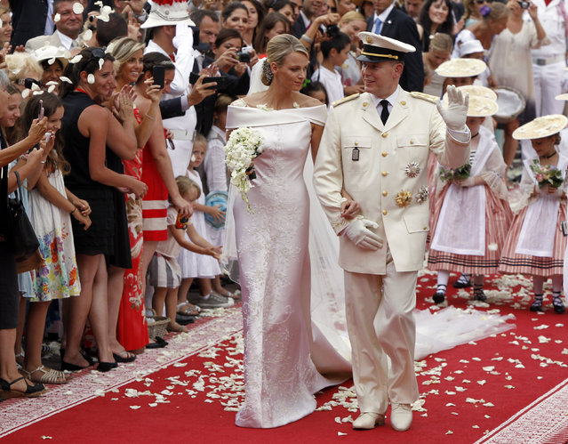 Prince Albert II of Monaco and Princess Charlene of Monaco depart from the Monaco palace after their religious wedding ceremony, July 2, 2011. (Photo by Joel Ryan/Reuters)