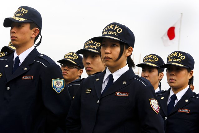 Members of the Tokyo fire brigade stand in formation during a New Year presentation in Tokyo January 6, 2015. (Photo by Thomas Peter/Reuters)