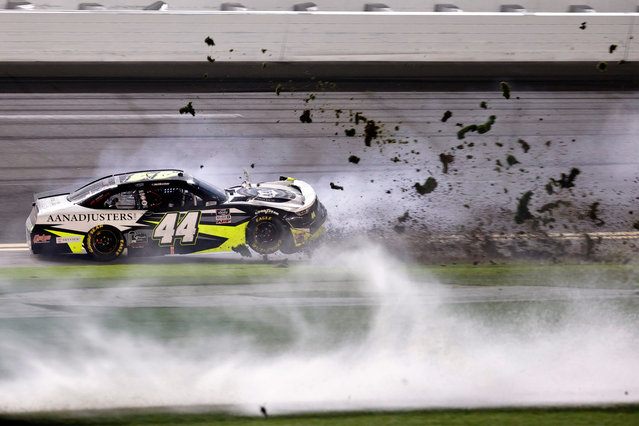 Tommy Joe Martins, driver of the #44 AAN Adjusters Chevrolet, spins into the grass during the NASCAR Xfinity Series Beef. It's What's For Dinner. 300 at Daytona International Speedway on February 13, 2021 in Daytona Beach, Florida. (Photo by Jared C. Tilton/Getty Images)